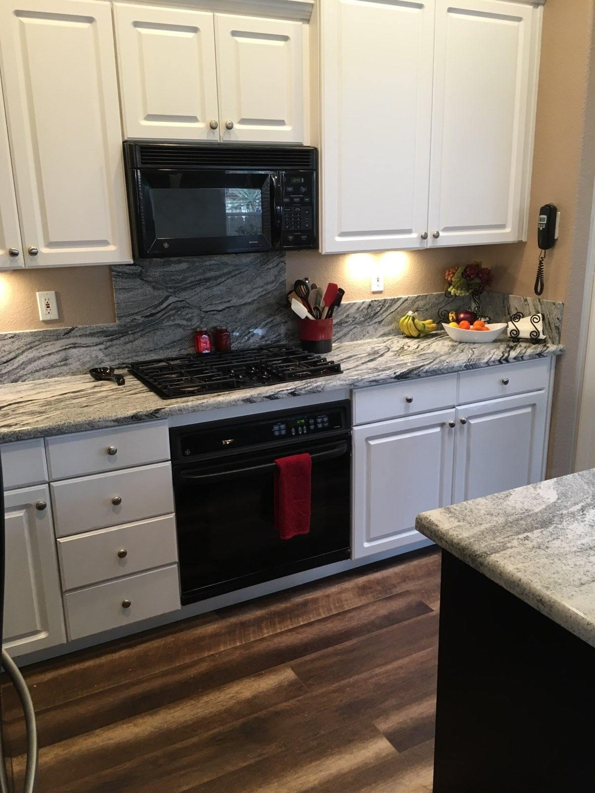 Viscount White Granite Kitchen Countertops with a Demi Bullnsoe